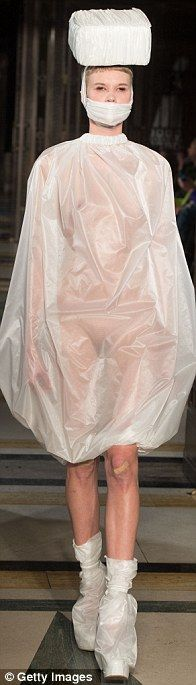 Sheer: The plastic poncho didn't quite conceal this model's assets