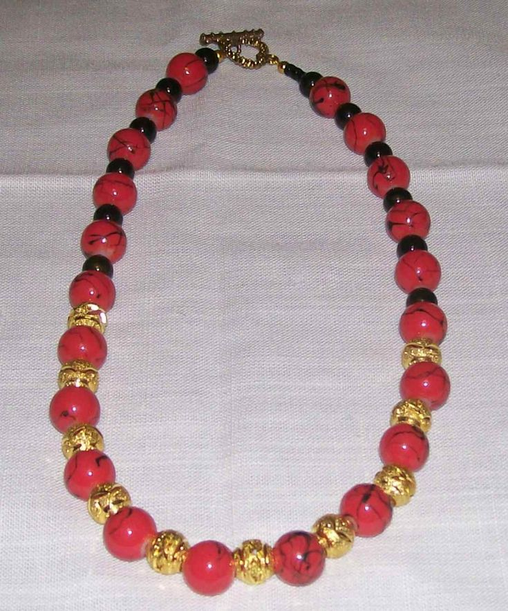 red and black bead necklace with black beads and gold spacers - A$15.00
