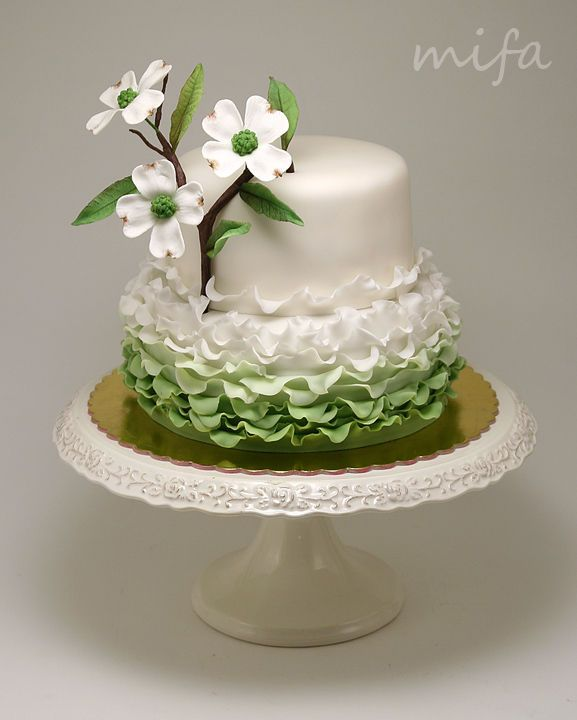 Fondant ruffles and gumpaste dogwood flower on 8 and 6 inch cakes