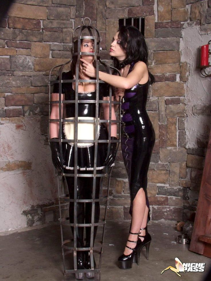 image Kinky mistress cages her slave outdoors