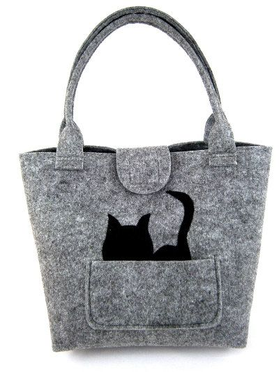 The bag was made from stabilized felt. Felts thickness is 0.16 / 4mm, so the bag keep its shape. To carry in hand and in shoulder. In front of bag there is one pocket and original black cat. Inside there are two pockets. The bag doesnt have a lining. The bag have magnetic closure.  Dimensions: - width: 12 / 31 cm - height: 16 / 41 cm - length of holder: 21,5 / 55 cm - width of the base: 6,5 / 16 cm  This item will be shipped to you within 1 to 3 days after the payment is received. All bags…
