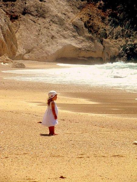 Baby girl on golden sand