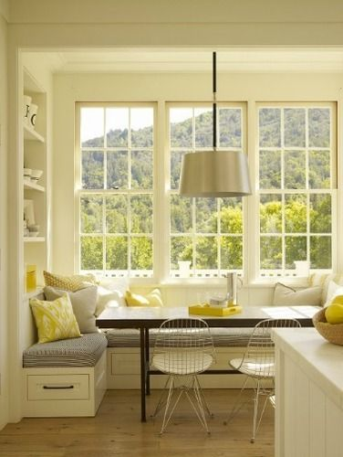 Breakfast nook - In love!  I don't know that I would want banquette seating but everything from the colors to the window, to the table texture, and the single lamp chandelier make me swoon!