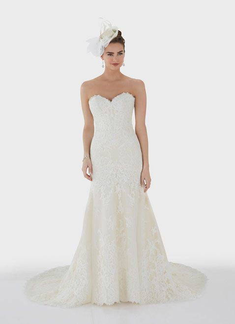 This sweet and classic trumpet gown is decorated with delicate corded, floral lace. With a figure flattering sweetheart neckline and full trumpet skirt, this dress is finished with covered buttons and a graceful lace border to the end of the modified chapel length train.<br ></a>Lining: Off White, Champagne<br />Lace, Tulle: Off White