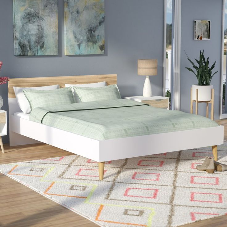 Design your dream bedroom around this mid-century modern style queen-sized panel bed. Made in Denmark from a mixture of solid PEFC certified sustainable woods, this Scandinavian design features a white rectangular frame contrasted by round tapered birch legs. 14 support slats offer a platform for your preferred mattress, while the two-tone white and natural oak-hued headboard offers visual appeal. To create an understated ensemble in the master suite, start by setting a lacquered wood…
