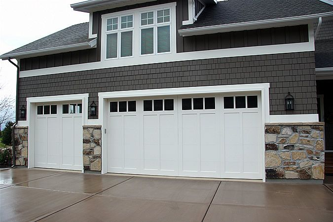 Lane Myers Construction Custom Home Builder Field of Dreams Garage Doors White White Trim Stone Exterior Gray Paneling