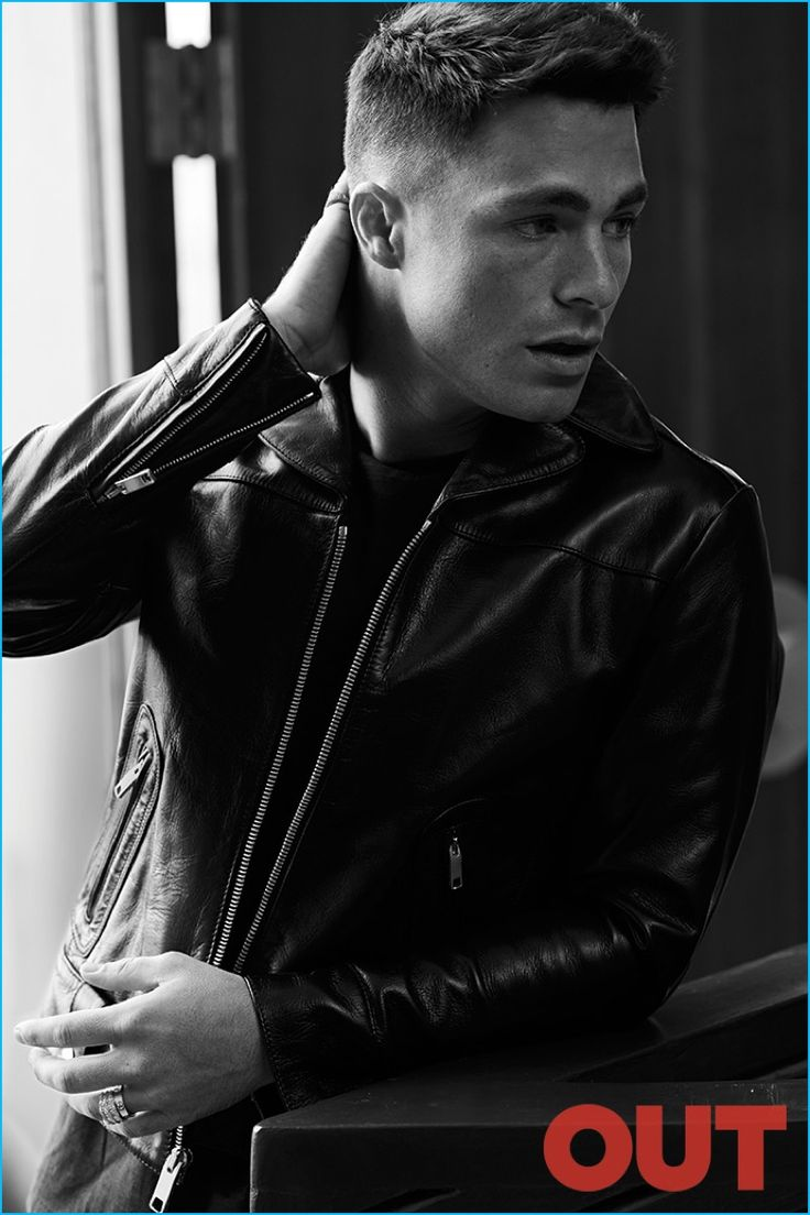 Colton Haynes poses for a black & white image, wearing a John Varvatos shirt with a Marc Jacobs leather jacket.