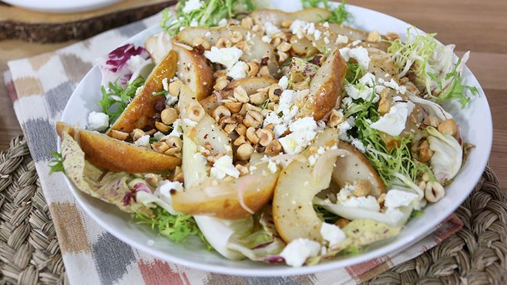 Winter salad with roasted pear, feta and hazelnuts
