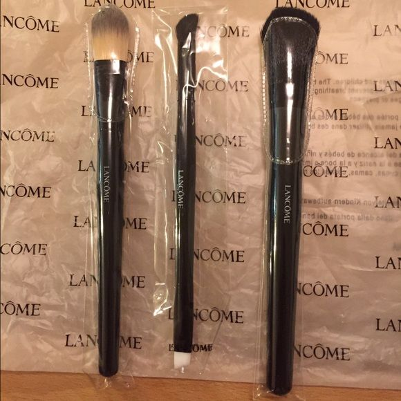 NWT Lancome  brush set NWT Lancome 3 professional make up brushes with case bag. Never used. Lancome Makeup Brushes & Tools