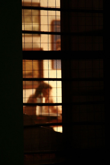 Looking through night windows at a slice of life:  A lonely night home....