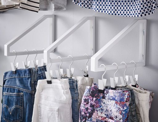 Turn a wall into your wardrobe with some upside shelf brackets and see all your clothes clearly. Perfect for sorting the t-shirts from the jeans.