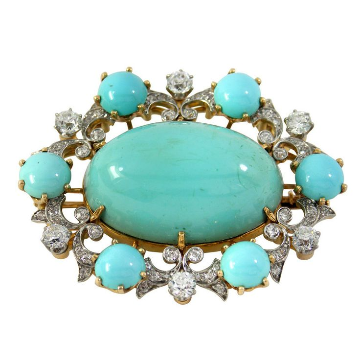 One ladies Victorian period brooch set with turquoise and diamonds. Constructed with an 18K yellow gold frame it features a platinum top to highlight its beautiful white diamonds. It is set with six 8mm round cabochon turquoise orbiting it's high domed oval cabochon center turquoise measuring 33mm X 20mm. Adding brilliance to this piece are assorted Old Mine Cut diamonds