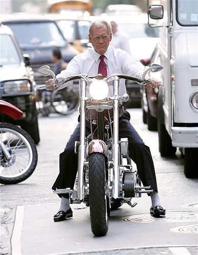TV David Letterman keeps his suit and tie on for a ride in New York City traffic.