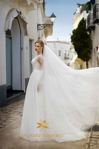 """The first model opening new CAPRI 2017 Collection """"Diana"""" .  This gentle dress decorated with delicate french lace and embroidered with pearls and sequins  The bottom of the dress made with soft tulle  7 West Model Angelina Shmyr"""