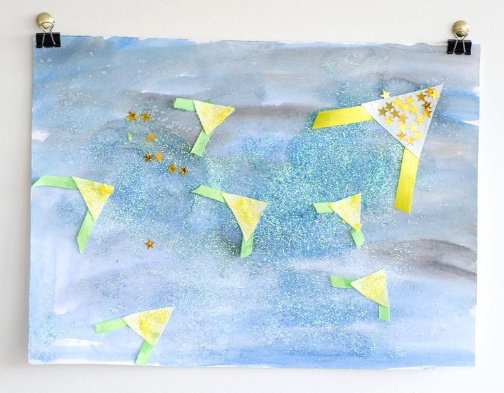 Lovely Matariki water paint and glitter art - a project you can do with kids inspired by the book  The Seven Kites of Matariki.