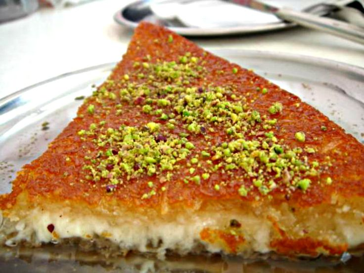 Here is an impressive video that shows the recipe for Lebanese Knafeh Naama. The chef here makes the crust with shredded phyllo dough and bread crumbs. This...