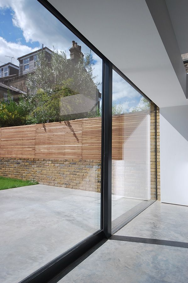 Continuity at the threshold. Concrete, brick, wood.