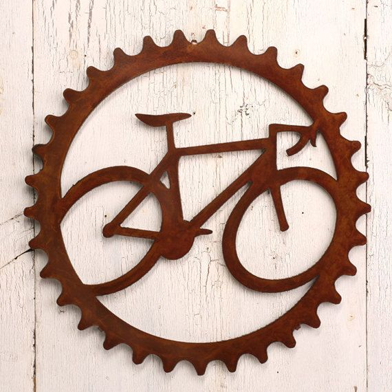 wall art: gear ring with bike image cut-out steel. great for husband's office.