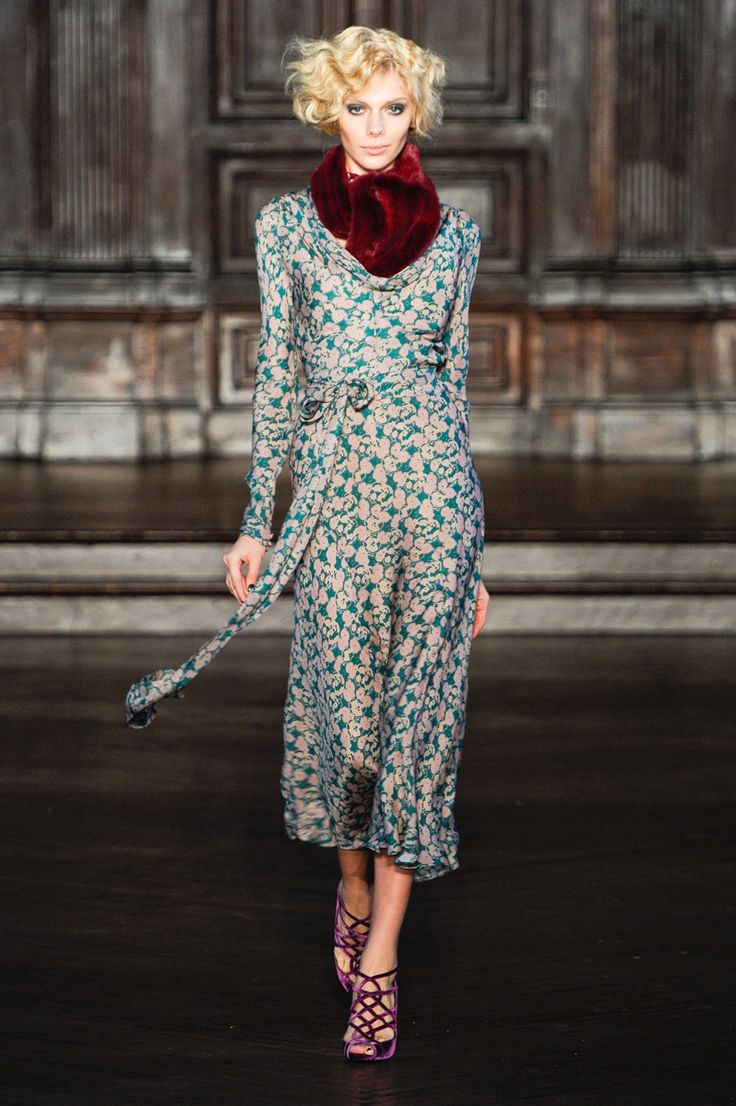 L'Wren Scott. The blue color in this print is genius. The silhouette of the wrap dress is beautiful. The cut of the shoulders differentiate it from piece like those of Diane Von Furstenburg.