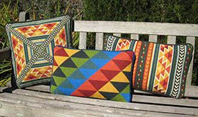 Three coordinated colorful pillows in primary colors: TABRIZ at left, TRIANGLES in center, TABRIZ BACK PILLOW at right - easy and fun to stitch