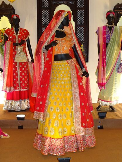 This bright yellow lehenga with the red dupatta is the perfect way to brighten any occassion.  Designer: Vidhi Singhania