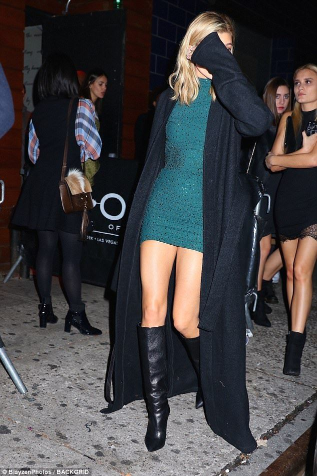 Birthday girl: The catwalk queen wowed in an ultra short teal dress and floor-sweeping coat as she partied the night away with friends
