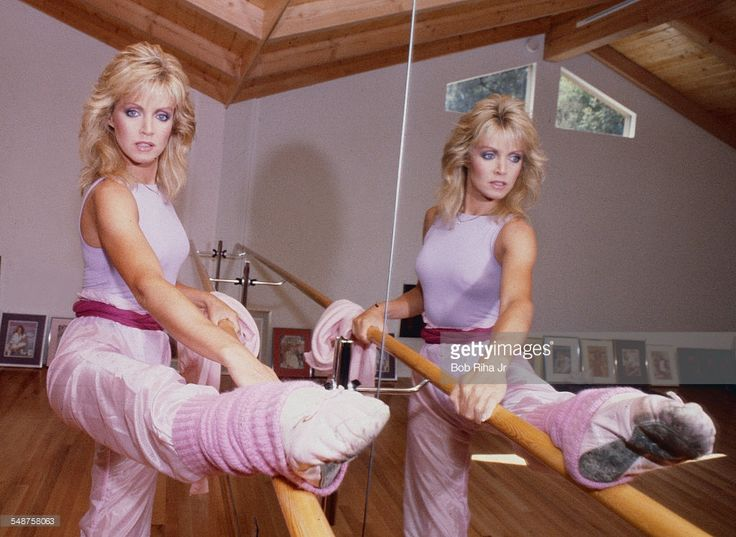 Portrait of American actress Donna Mills as she performs barre exercises in her home dance studio, Beverly Hills, California, March 18, 1983.