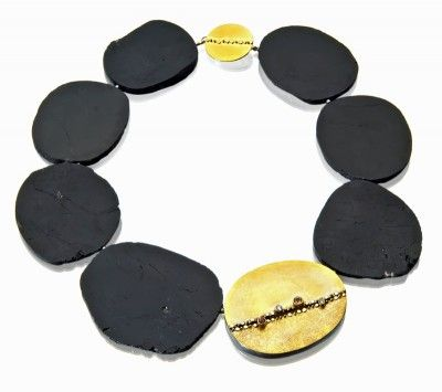 Black tourmaline necklace, sydney lynch. love the small gems set linearly on the gold ovals.