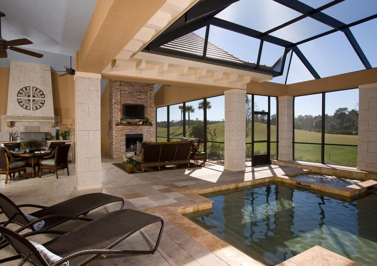 I like this idea, with a smaller shallow pool area just to sit in and relax, and have it right next to the outdoor lounge area, so you can watch the fireplace/TV.