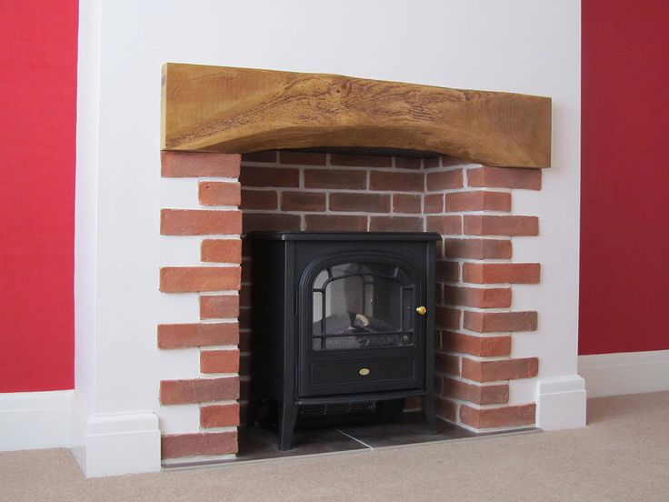 A Fireplace With Oak Beam And Sussex Red Multi Stock Brick Slips Extension Pinterest