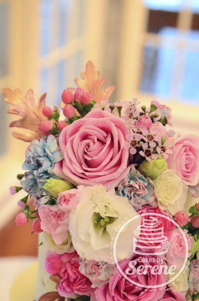 Fresh floral naked wedding cake