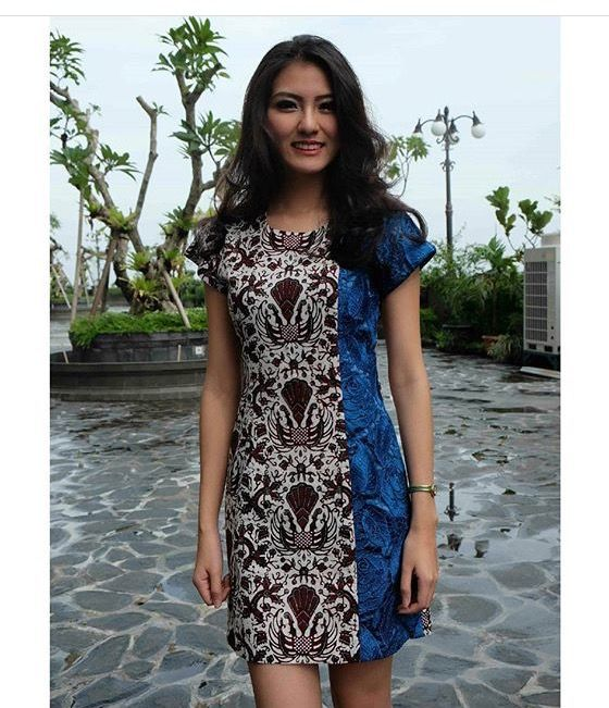 Batik shift dress, divided lengthwise: 3/4 brown-white, 1/4 blue tones                                                                                                              More