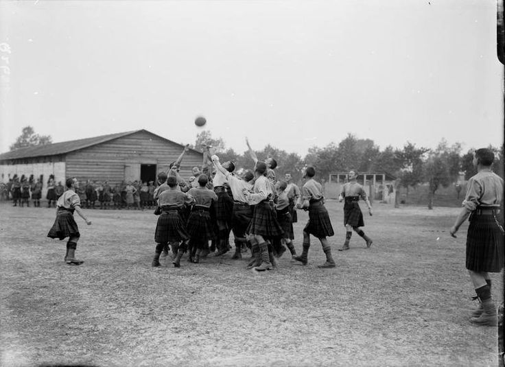 Troops of the 9th Battalion, Highland Light Infantry (Glasgow Highlanders), 100th Brigade, 33rd Division, playing rugby football at Ghyvelde, 6th August 1917