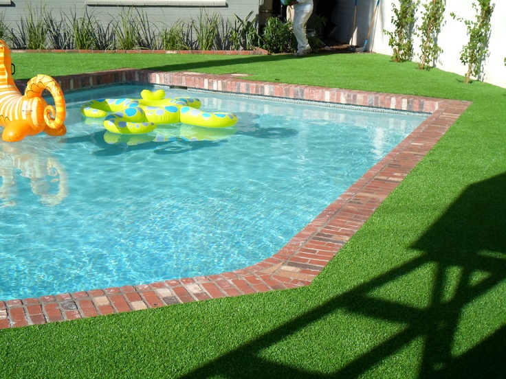 Beautiful Green Grass to match up with your pool all year round! Installed by Arizona Turf Masters Supplied by The Synthetic Grass Store