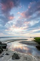 """Sunset on the South End, Amelia Island, Florida<br /> <br /> """"A slough is a deep trough, usually running parallel to the beach, bordered by a sand bar on one side and the beach on the other. The distance from the beach to the bar determines the width of the slough. Fish travel up and down this slough and look for food in the dynamic surf zone of breaking waves and strong currents."""" (Joe Malat)"""