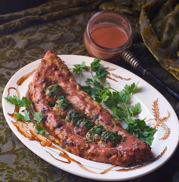 Leche Lumbarde (spiced ground pork) from the 14th century, a ground pork dish made to look like peas in a pod with a spiced red wine/almond milk sauce to die for... served at the Coronation of Henry IV