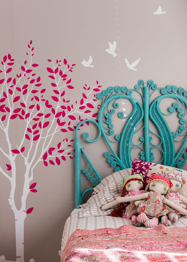 pretty bed headboard and wall mural will grow nicely with any young lady in this pretty girl's bedroom (Get the look with Oopsy Daisy http://www.oopsydaisy.com/2014/01/get-look-tree-artwork-for-kids-rooms/)