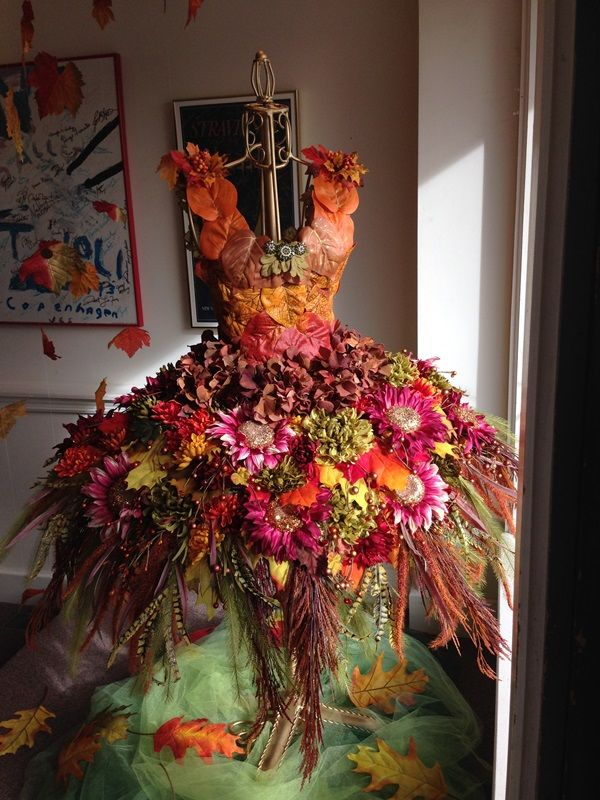 silk flowers on a wire dress forms for a fall foliage display