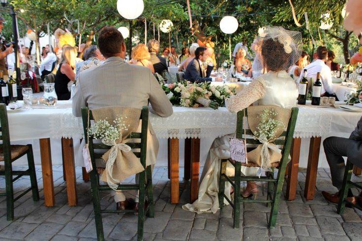 The bride and grooms decorated chairs - in a greek garden wedding #destinationwedding #greekgardenwedding #naxosislandweddings