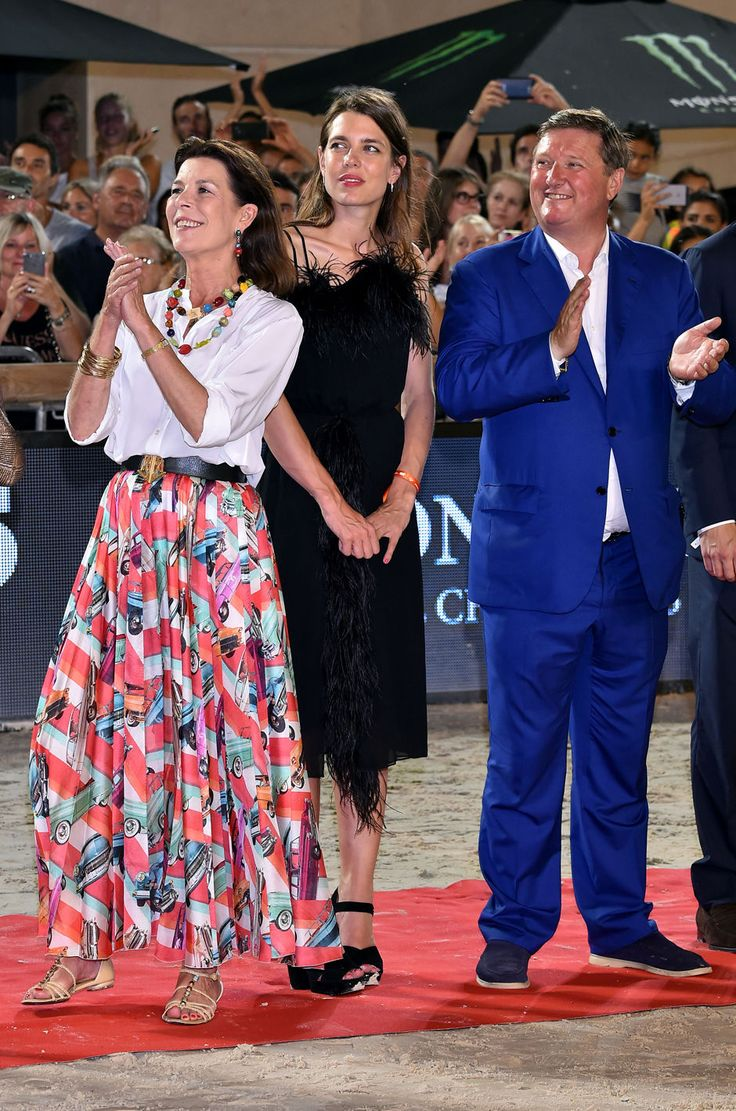 Charlotte Casiraghi (C) and Princess Caroline of Hanover (L) attend a ceremony during the 2017 edition of the Jumping International of Monaco horse jumping competition as part of the Global Champions Tour on June 24, 2017 in Monaco.