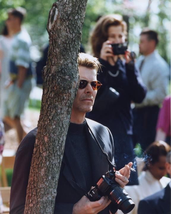 dillybcys:  David Bowie taking photos of his son's graduation at the College of Wooster in Wooster, OH (1995)