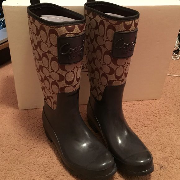 Coach rain boots Coach rain boots. Brown and tan. Never worn before. Brand new. Excellent condition.OPEN TO OFFERS . Needs to go by this week Coach Shoes Winter & Rain Boots