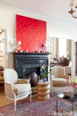 Black fireplace surround and bold print above. From a fresh coat of white paint to choosing comfortable, neutral furniture, decorating experts shar