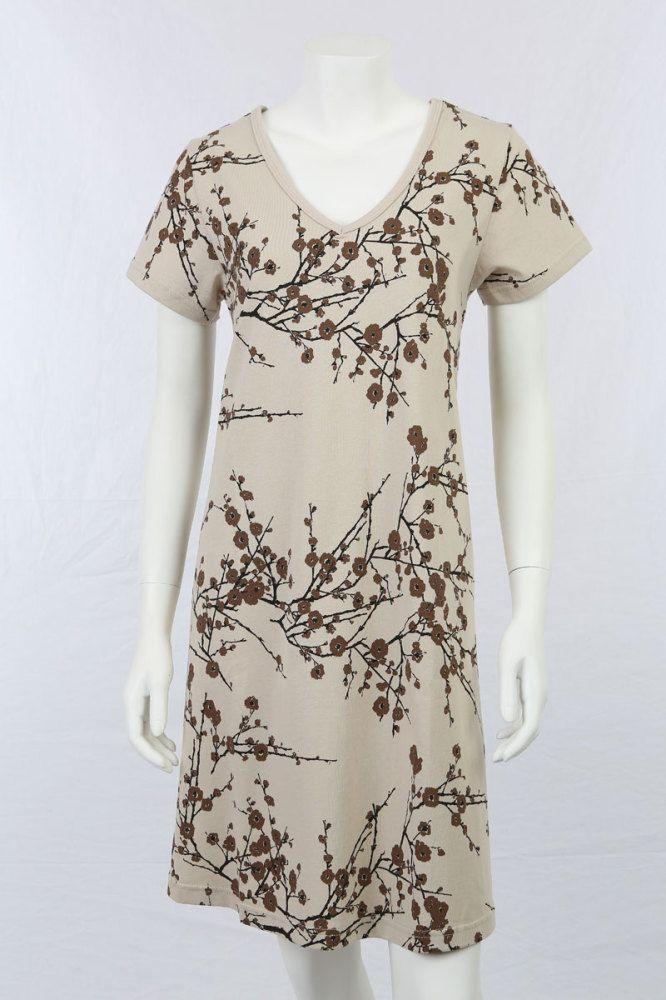 A-kjole i beige med print.