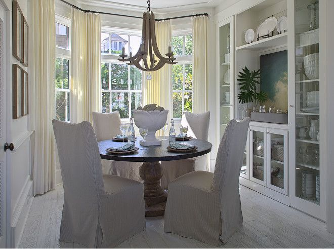 Beautiful Cottage Breakfast Nook Features Bay Windows Dressed In Cream Curtains Filled With Round Pedestal Dining Table Lined Linen Slipper