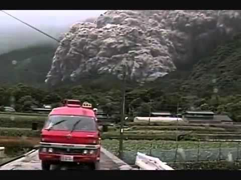 The dome of Unzen, Japan Volcano collapsed and created a pyroclastic flow in '91. The people here escaped when the flow stopped before reaching them, but the deadly and terrible speed of it, is astonishing.  Pyroclastic flows are fluidized masses of rock fragments and gases that move rapidly in response to gravity. They  can form in several different ways, such as when an eruption column collapses, as the result of gravitational collapse or from an explosion on a lava dome.