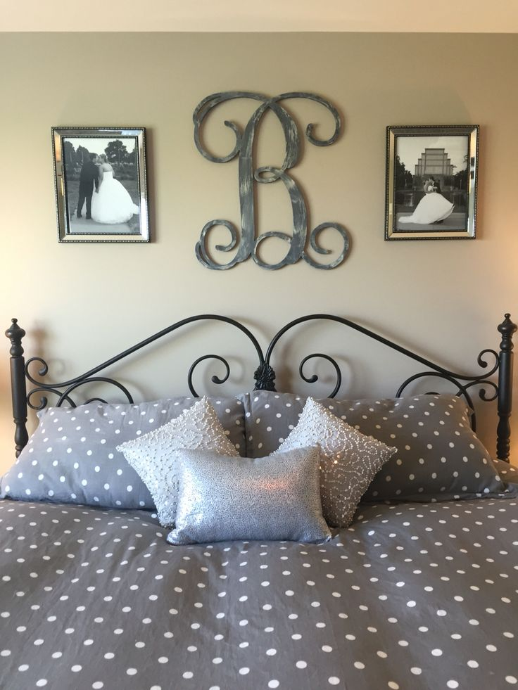 Idea for above the bed in master bedroom. Monogram and picture frames