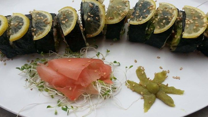 Short grain brown rice, avocado, red bell pepper, and alfalfa sprouts are rolled in nori seaweed sheets for a delicious vegetarian sushi roll.