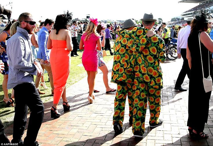 We've had a good day! Two race goers in very colourful attire head home after a great day ...
