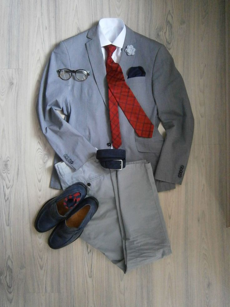 blue grey cotton unlined jacket with blue buttons / light grey chinos / white long arm shirt / red tie with blue windows / blue suede belt / blue leather loafers / deep blue silk handkerchief / white crocheted boutonniere / red blue striped socks / tortoise-shell glasses